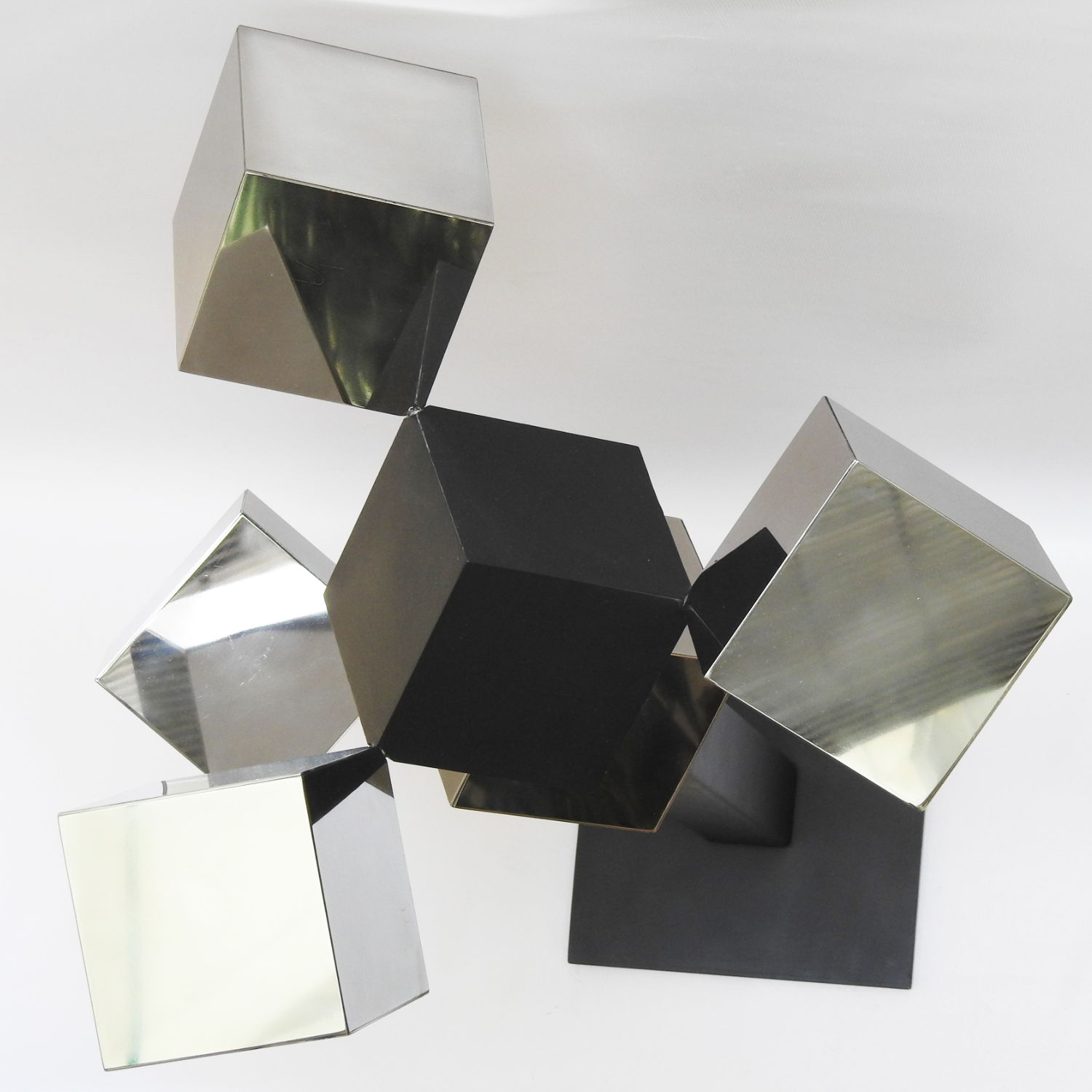 A photo of a cubic metal sculpture